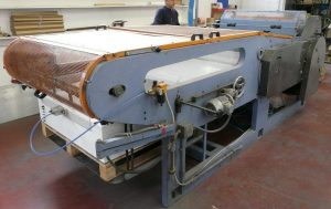 Plastic film and paper slitting machine